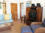 Living Area with Entertainment Center and Caribbean Decor