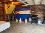 Grill and outdoor games are in the garage.