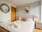 Lakeside double bedroom, with full panormic glazing and private balcony area