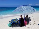 Canuck Palms beach chairs and umbrella.