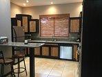 new kitchen cabinets and granite countertops.