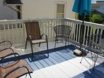 freshly painted outdoor deck with seating