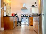 Open, fully equipped kitchen.