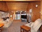 Living Room w/ comfortable sofa-sleeper, recliner, 50in HD Streaming  TV