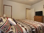 Master Bedroom has King bed and 32 in. HD Streaming TV