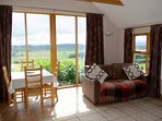 Living and dining area making the most of the spectacular south facing views
