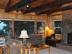 Expansive Great Room with Vaulted ceiling and views of the Lake & Mountains