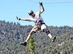 4 Seasons Of Fun Cabin owner enjoying Ziplining among the treetops in Big Bear Lake CA