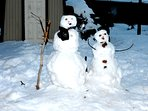 Building snow people in the large Back Yard