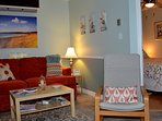 Charming, cozy living room w/ Lazy Boy Sleeper Sofa, chairs,TV, fireplace, patio doors lead to deck