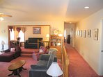 Living Room, Den in Background, Ansel Adams Photos in Hallway going to Master Bedroom