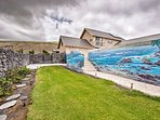 Play on the lawn and admire the ocean mural by Ron Libbrecht.