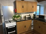 Fully equipped kitchen includes espresso maker, toaster, microwave, kettle, mixer, scales etc