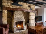 ...and a large inglenook fireplace with a cosy open fire
