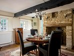 Leading through into the lovely dining area which comfortably seats four guests