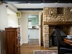 There is a second inglenook fireplace, with an ornamental stove, & this room leads into the kitchen