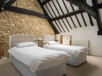 Bedroom 2, a well presented eaves room which contains two single beds