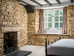 Including exposed stone walls and a beautiful ornamental stone fireplace
