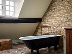 Up on the second floor is the master bedroom's ensuite bathroom...
