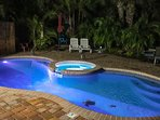 Warm evenings in the LED-lighted Heated Pool & Spa located in the tropical backyard