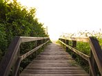 Cross the dune to the beach using the walkway that's a few seconds away from the house on foot.