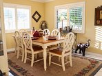 Top Floor: Open Plan Living includes dining table with ocean views from almost every seat