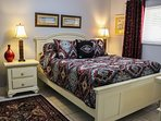 The second Master Suite is at Ground Level with Queen Bed, HDTV & DVD, En Suite Bathroom & Walk-In