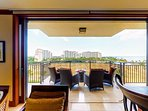 Aerial views of the Lagoon Pool and the ocean from the living room of this Ko Olina beach villa for rent.