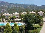 Beautiful landscaped gardens in mountainous backdrop