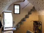 Steep stone steps to the living area and terrace