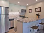 Photo of newly renovated kitchen with stainless appliances, granite counter top, and cabinetry