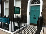 Charles Dickens' house, now a museum, is just around the corner