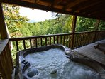 Hot tub on back deck overlooking view