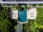 Aerial view of the swimming pool in balinese stones