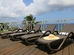 Eight sun loungers at different spots along the terrace.