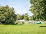 The village green and play park is ideal for families with children