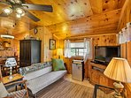 Relax in the rustic living area as you watch your favorite show on the TV.