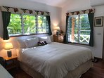 Bedroom with California King size bed, a/c, 2 closets & garden views.