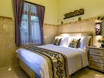 Queen-size bed in the second, slightly smaller bedroom. Well organized and functional.