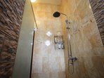 Waterfall shower as well. Bathrooms are fully tiled from floor to roof. Shining clean.