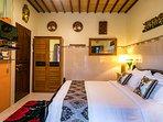 Comfortable Queen-size bed in the Guesthouse. Enjoy the en-suite bathroom.