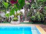 Dewi Sri , the Balinese Goddess of rice and prosperity is looking after the pool and garden.