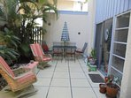Large patio with table that seats 6, lounge rockers with new cushions and an outdoor shower.