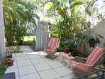 Large patio with lush tropical plantings. Morning shade and full sun in the afternoons.