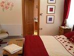 Master bedroom showing access to en suite shower room