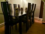 Dining table and chairs night time view - seats 12 people