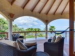 Covered Upstairs Lounge area overlooking beach and private gardens