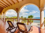 Covered Balcony overlooking beach and pool in front of Master Suite