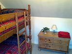 Bunk bedroom with full size beds suitable for both children and adult guests