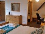 Huge king bedroom with en-suite, desk area and oak furniture